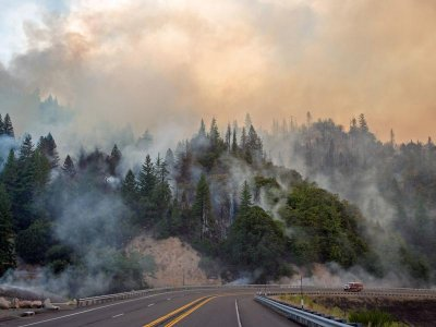 A firetruck drives along Highway 299 as the Carr fire continues to burn near Whiskeytown, California on Saturday.